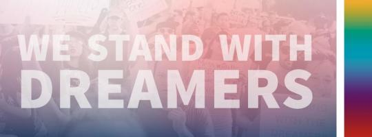 """banner that reads """"We Stand with DREAMers"""""""