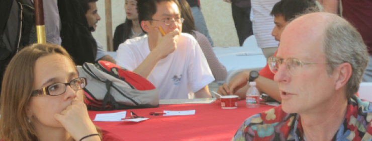 Student talking to faculty member at an event