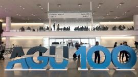 """AGU 100"" in large letters at a conference hall"