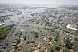 aerial photograph of homes surrounded by floodwater