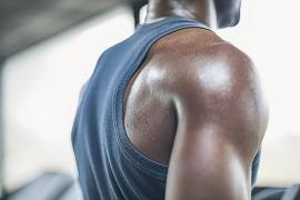 close up shot of a person's shoulder with sweat