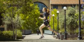 Stanford graduate student, Delaney Miller, wearing the energy expenditure monitoring system while running on campus.
