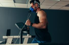 A person on a treadmill with a mask over their face
