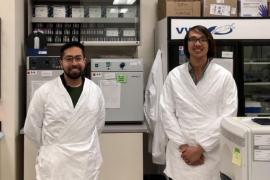 Jose Miguel Andrade Lopez and Paul Bump stand in a lab