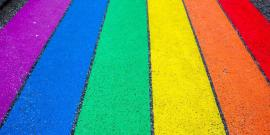 Road with rainbow stripes painted on