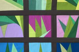A quilt design of leaves.