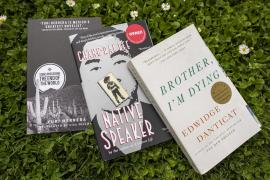3 books laid out on grass