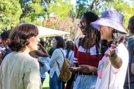 VP Stacey F. Bent chatting with Stanford grad students during an NGSO event.